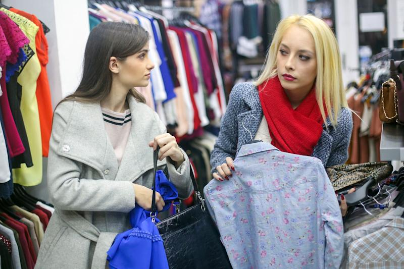Two female friends shoplifting. Source: Getty