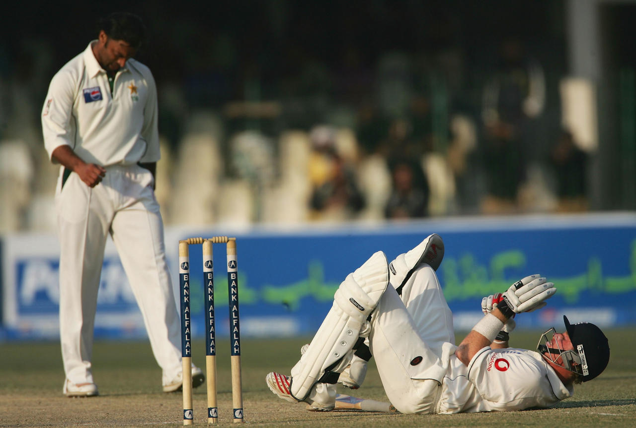LAHORE, PAKISTAN - DECEMBER 2:  Ian Bell of England gets knocked to the ground after being hit by a Shoaib Akhtar delivery during the fourth Day of the Third and Final Test Match between Pakistan and England at The Gaddaffi Stadium on December 2, 2005 in Lahore, Pakistan.  (Photo by Julian Herbert/Getty Images) *** Local Caption *** Ian Bell