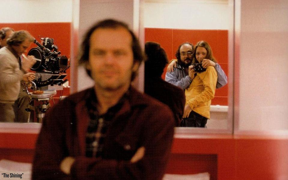 "<p>Director Stanley Kubrick and his daughter, Vivian Kubrick, are photographed in a mirror behind a blurred out Jack Nicholson on the set of the horror movie adapted from the Stephen King novel, <em><a href=""https://www.amazon.com/Shining-Stephen-King/dp/0307743659"" rel=""nofollow noopener"" target=""_blank"" data-ylk=""slk:The Shining"" class=""link rapid-noclick-resp"">The Shining</a>. </em></p>"