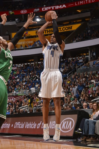 ORLANDO, FL - JANUARY 19: Arron Afflalo #4 of the Orlando Magic shoots the ball against the Boston Celtics during the game on January 19, 2014 at Amway Center in Orlando, Florida. (Photo by Fernando Medina/NBAE via Getty Images)