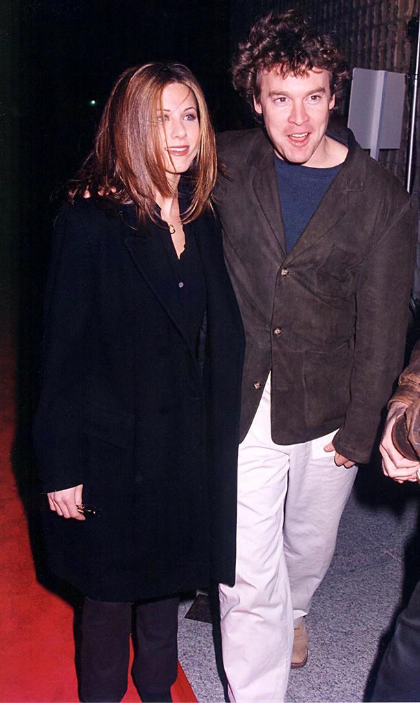 <p>Aniston brought then-boyfriend Tate Donovan to the premiere to support her best pal and <em>Friends</em> co-star Courteney Cox. (Photo: Jeff Kravitz/FilmMagic) </p>