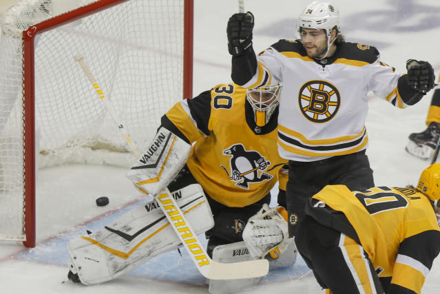 Boston Bruins' Jake DeBrusk (74) celebrates a goal by teammate Anders Bjork on Pittsburgh Penguins goaltender Matt Murray during the first period of an NHL hockey game, Sunday, Jan. 19, 2020, in Pittsburgh. (AP Photo/Keith Srakocic)