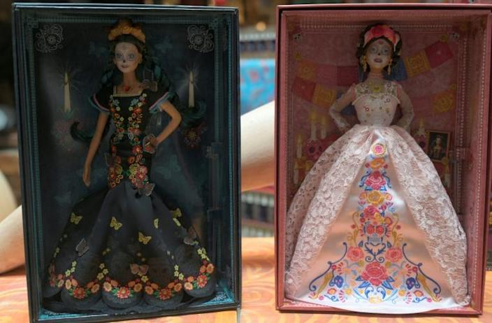 The new Day of the Dead Barbie (R) wears a blush-colored lace dress while the 2019 edition was dressed in black