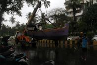 MUMBAI, INDIA - JUNE 03: Fishermen relocate a boat as part of precautions against Cyclone Nisarga in Mumbai, India on June 03, 2020. A storm in the Arabian Sea off India's west coast intensified into a severe cyclone on Wednesday, gathering speed as it barreled toward India's financial capital of Mumbai. Nisarga was forecast to drop heavy rains and winds gusting up to 120 kilometers (75 miles) per hour when it makes landfall Wednesday afternoon as a category 4 cyclone near the coastal city of Alibagh, about 98 kilometers (60 miles) south of Mumbai, India's Meteorological Department said. (Photo by Imtiyaz Shaikh/Anadolu Agency via Getty Images)
