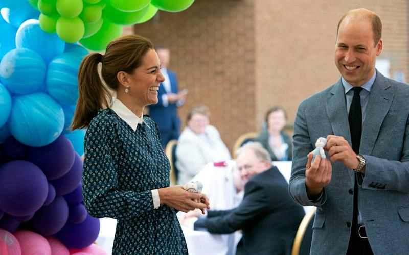 Prince William and Kate, Duchess of Cambridge visit the Queen Elizabeth Hospital as part of the NHS birthday celebrations - PA pool