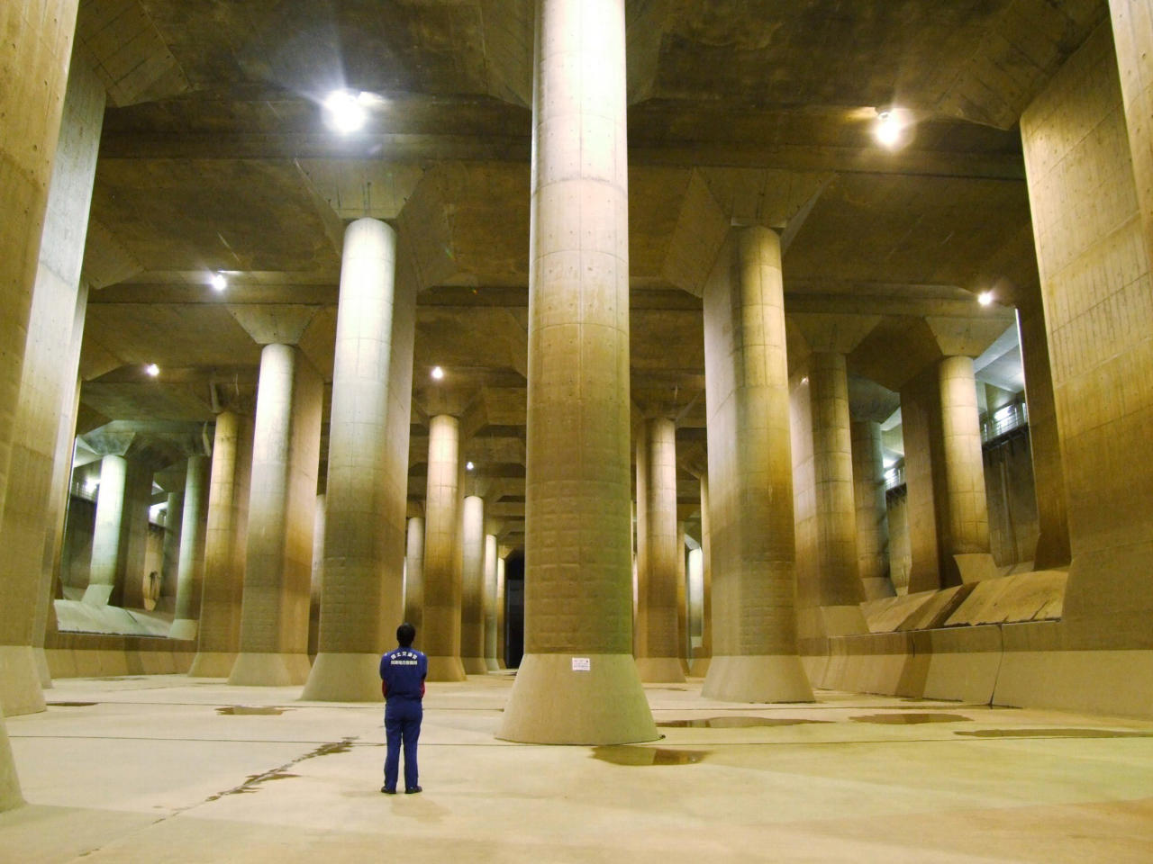 "The pressure-controlled water tank at the  Metropolitan Area Outer Underground Discharge Channel in Kusakabe, north  of Tokyo. The facility, which is  believed to be one of the largest facilities in the world, is composed of giant concrete containment  silos (65m tall, 32m wide), connected by 3.97 miles of  underground tunnels 50m beneath the surface as well as a large water  tank called the ""Underground Temple"" which is 25.4m tall, with a length  of 177m and 78m wide, with 59 concrete pillars. <br><br>(Photo: REUTERS/Ministry of  Land, Infrastructure, Transport and Tourism-Edogawa River Office/Handout)"