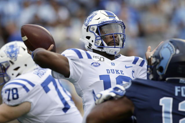 Duke quarterback Quentin Harris (18) passes during the first half of an NCAA college football game against North Carolina in Chapel Hill, N.C., Saturday, Oct. 26, 2019. (AP Photo/Gerry Broome)