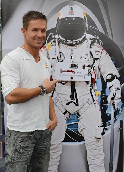 Austria's Felix Baumgartner poses for photgraphers after a press conference in Salzburg Austria , on Saturday Oct. 27, 2012 . Supersonic skydiver Felix Baumgartner has finally come home after his death-defying, record-breaking leap from the edge of space. The Austrian former military parachutist faced reporters in his home city of Salzburg on Saturday, nearly two weeks after his plunge from a balloon to the New Mexico desert made him the first person to reach supersonic speed without traveling in a jet or spacecraft. (AP Photo/Kerstin Joensson)