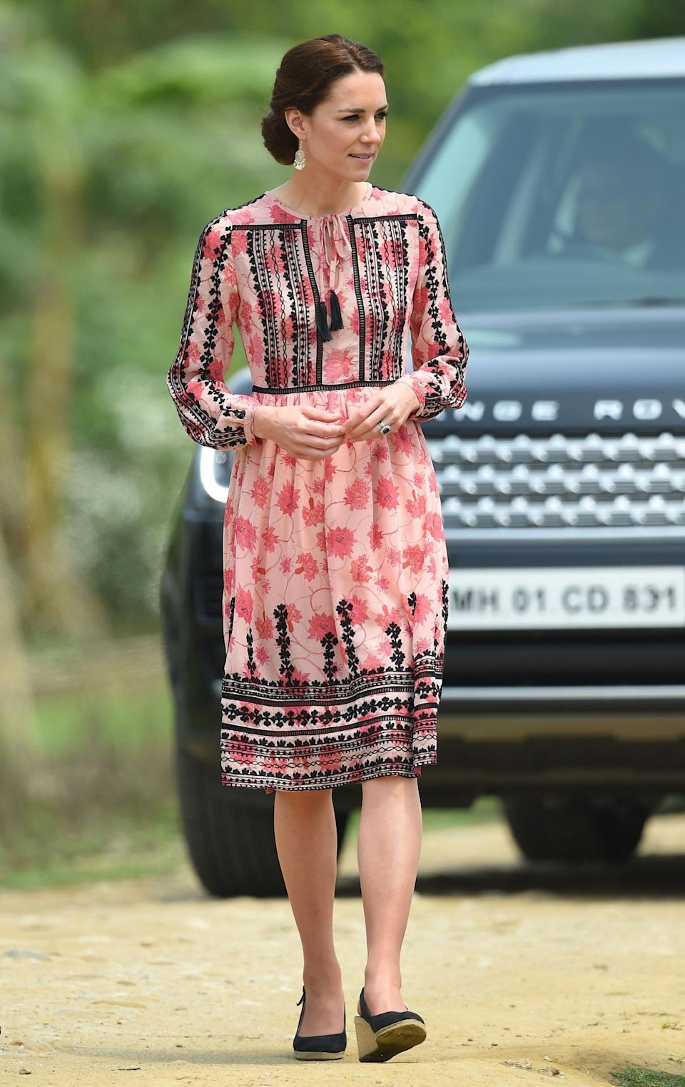 <p>On a trip to an Indian village, Kate went down the high street route in a pink-and-black Topshop dress and espadrille wedges by Dune. </p><p><i>[Photo: PA]</i></p>
