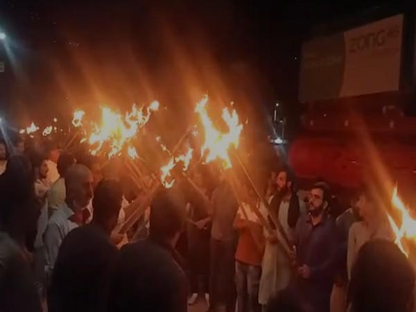 Massive protests and a torch rally was held in Muzaffarabad city of Pakistan occupied Kashmir (Photo/ANI)