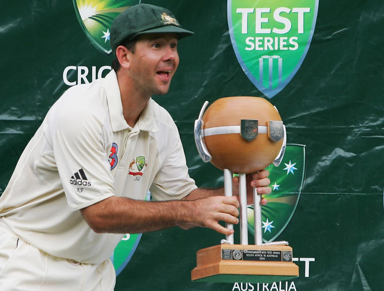 SYDNEY, NSW - JANUARY 06: Australian Captain Ricky Ponting shows off the trophy to his team mates after defeating South Africa during day five of the Third Test between Australia and South Africa played at the SCG on January 6, 2006 in Sydney, Australia.  (Photo by Chris McGrath/Getty Images)