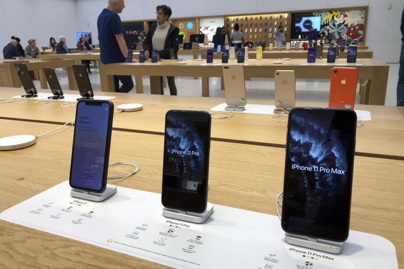A selection of iPhones are displayed an Apple store Tuesday, Jan. 28, 2020, in suburban Boston. Apple reports financial earns on Tuesday. (AP Photo/Steven Senne)