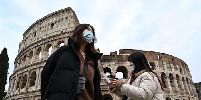 Tourists wear protective masks in Rome on January 31, 2020.