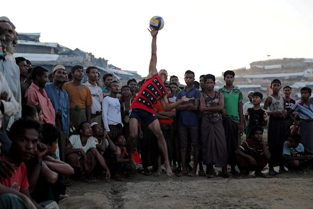REFILE - CORRECTING NAME OF DISCIPLINE Rohingya refugees play volleyball in a makeshift refugee camp in Cox's Bazar, Bangladesh November 8, 2017. REUTERS/Mohammad Ponir Hossain TPX IMAGES OF THE DAY