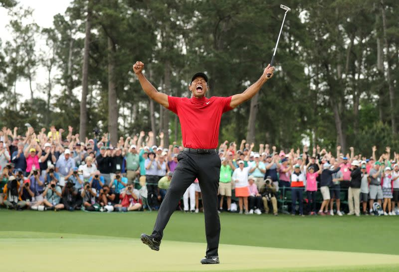FILE PHOTO: Tiger Woods celebrates victory at 2019 Masters