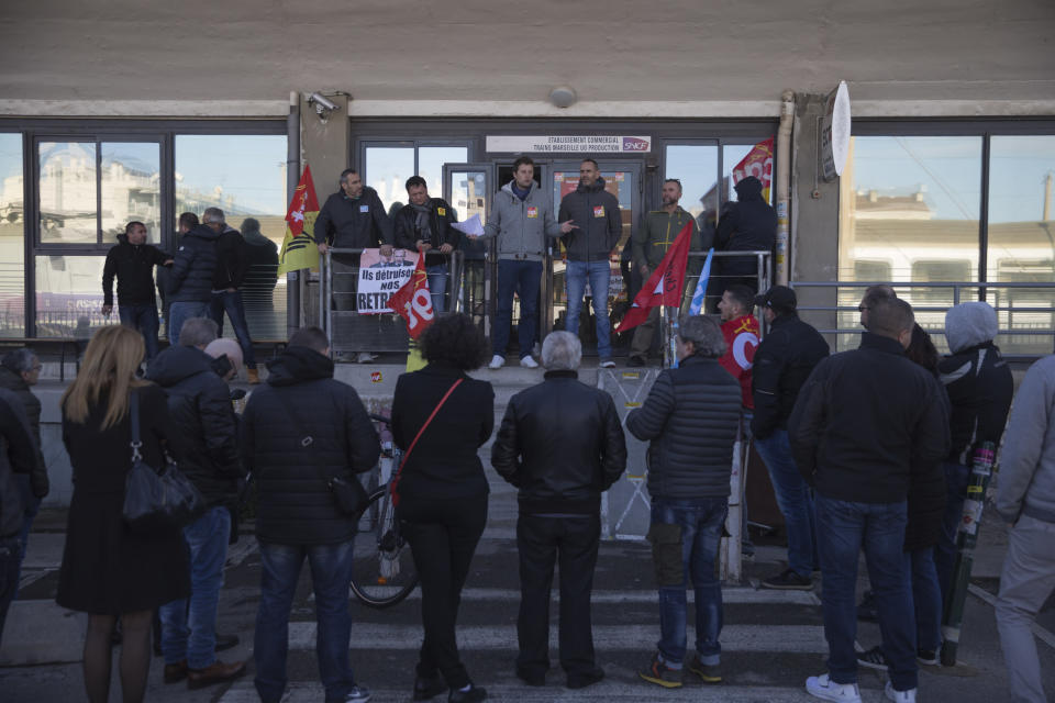 Railway workers gather for a union general assembly meeting at the Gare St-Charles station in Marseille, southern France, Monday, Dec. 9, 2019. Paris commuters inched to work Monday through exceptional traffic jams, as strikes to preserve retirement rights halted trains and subways for a fifth straight day. (AP Photo/Daniel Cole)