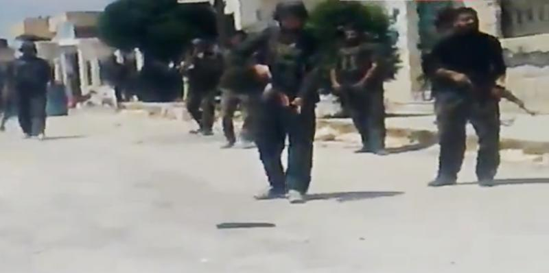 In this image made from amateur video released by Ugarit News and accessed Tuesday, May 15, 2012, purports to show Syrian government forces shooting toward people in Idlib, Khan Sheikhoun, Syria. A team of international observers were evacuated Wednesday from a tense town in northern Syria a day after their convoy was hit by a roadside bomb, a U.N. spokesman said. The team's vehicles were struck by the blast Tuesday during a mission in the northern town of Khan Sheikhoun. (AP Photo/Ugarit News via AP video) TV OUT, THE ASSOCIATED PRESS CANNOT INDEPENDENTLY VERIFY THE CONTENT, DATE, LOCATION OR AUTHENTICITY OF THIS MATERIAL