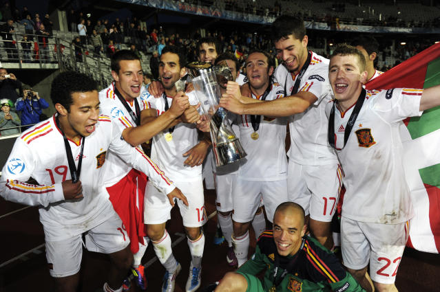 Spanish players celebrate with the trophy at the end of the UEFA Under-21 European Championship final football match Spain vs Switzerland at the Aarhus Stadium, on June 25, 2011. Spain won the final.AFP PHOTO/JONATHAN NACKSTRAND (Photo credit should read JONATHAN NACKSTRAND/AFP/Getty Images)