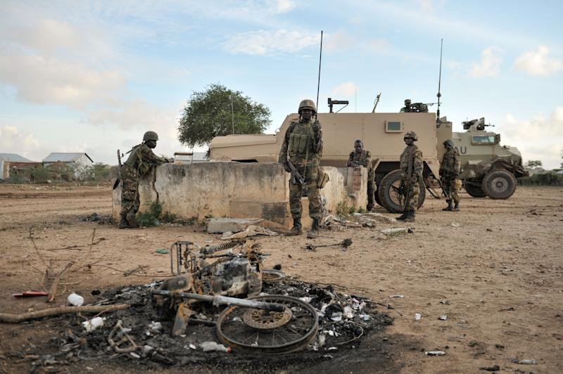 African Union soldiers from Uganda arrive in Kurtunwaarey in the Lower Shabelle region of Somalia on August 31, 2014, after liberating it from Al Shabab