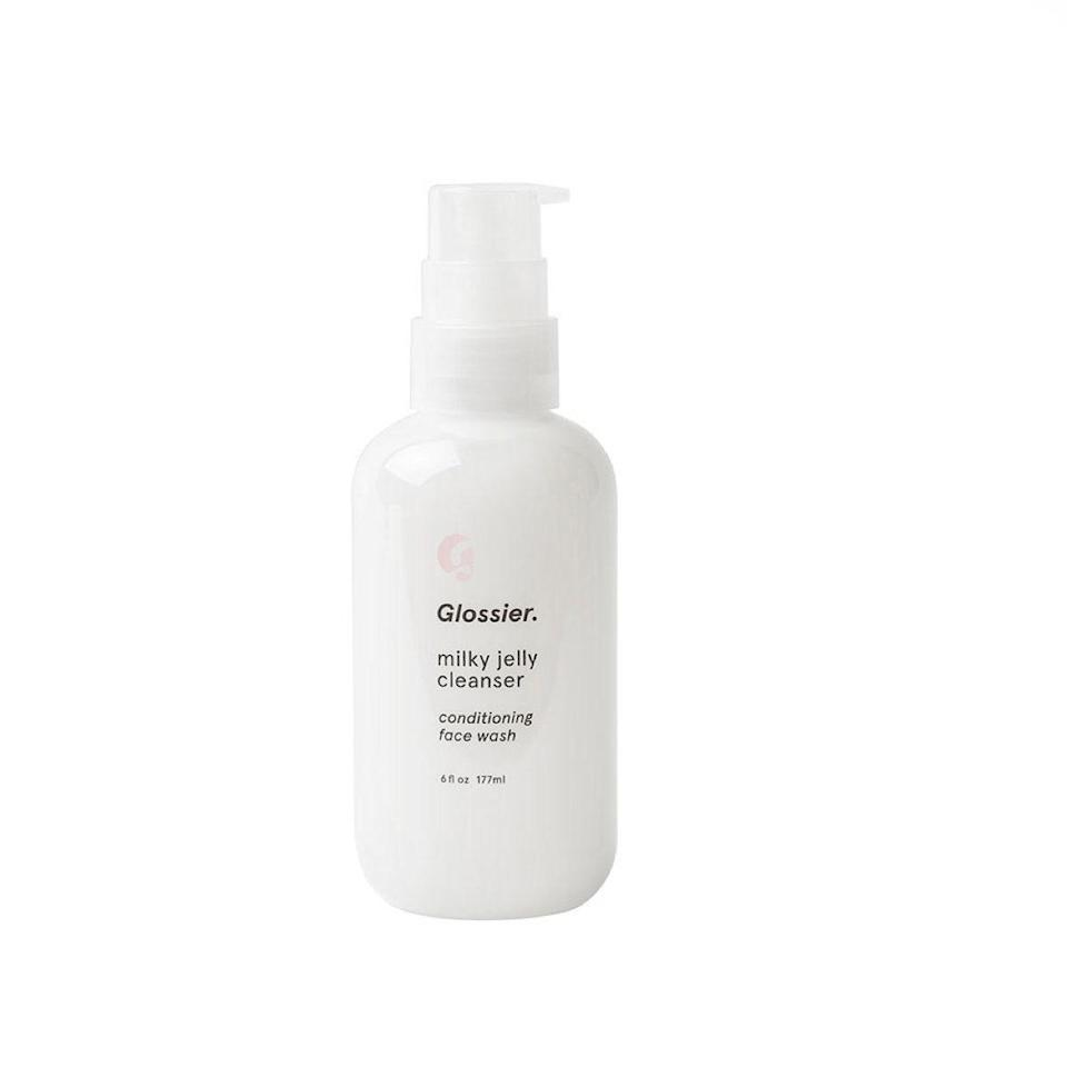 """I've been a fan of Glossier since day one, and most of its products have made their way into my daily routine (hi, Boy Brow!). But my love runs deepest for its Milky Jelly Conditioning Face Wash. The texture is unique—the only way I can describe it is cushiony—and it never leaves my skin feeling tight or stripped. I use it in the morning on dry skin and at night after an oil cleanser or micellar water to remove makeup. The smell is incredible: It's like roses and lipstick, but it's subtle enough not to irritate my sensitive skin. I will always have a bottle in my bathroom because it works, and it honestly just makes me happy when I use it, which is what beauty is all about. <em>—B.C.</em> $18, Glossier. <a href=""""https://glossier.79ic8e.net/NDyZ1"""" rel=""""nofollow noopener"""" target=""""_blank"""" data-ylk=""""slk:Get it now!"""" class=""""link rapid-noclick-resp"""">Get it now!</a>"""
