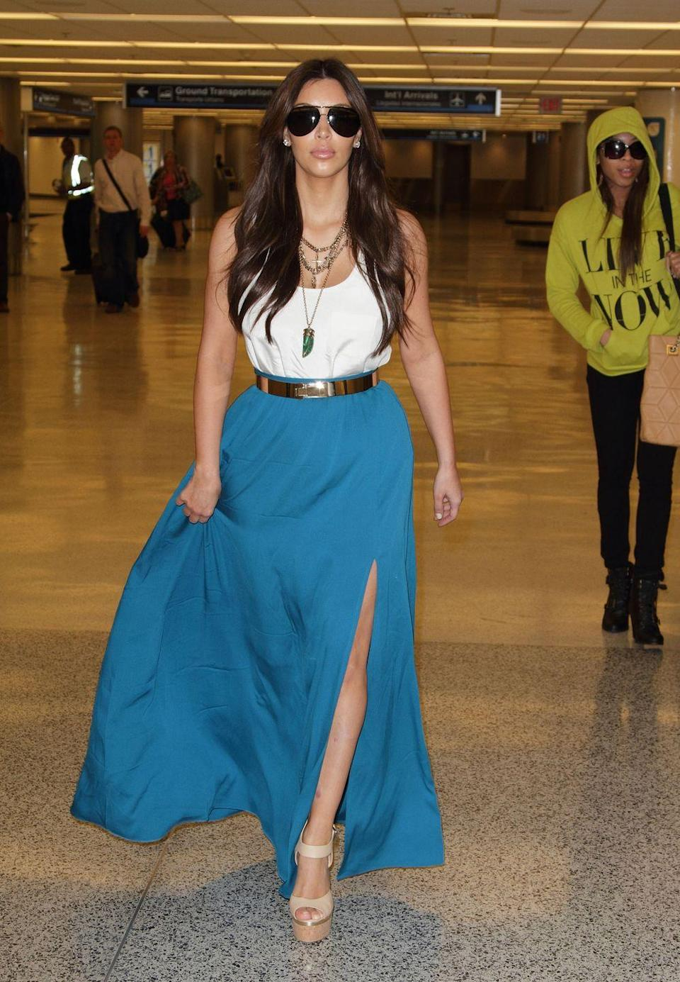 <p><strong>Kim Kardashian, 2012: </strong>Having to carry your skirt as you walk is glamorous when you're strolling a red carpet. When you're hustling through the airport, it's just dumb.</p>