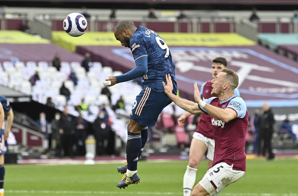 Arsenal's Alexandre Lacazette scores his side's third goal during the English Premier League soccer match between West Ham United and Arsenal at the London Stadium in London, England, Sunday, March 21, 2021. (Justin Tallis, Pool via AP)