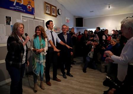 Liberal leader and Canadian Prime Minister Justin Trudeau and his wife Sophie Gregoire Trudeau visit a Royal Canadian Legion as he campaigns for the upcoming election, in Greenfield Park