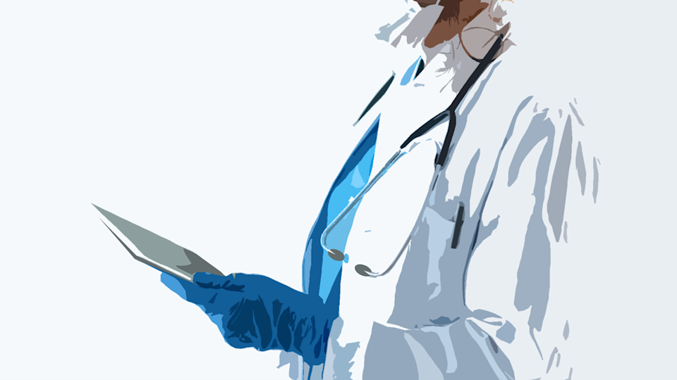 A doctor in facemask and gloves holds an electronic tablet.