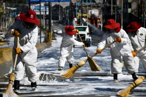 Municipal workers in Arequipa, the second largest city in Peru, clean roads around the main market
