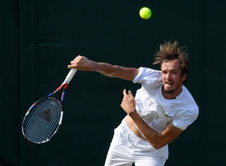 FILE PHOTO: Tennis - Wimbledon - All England Lawn Tennis and Croquet Club, London, Britain - July 6, 2018. Russia's Daniil Medvedev serves during the third round match against France's Adrian Mannarino.  REUTERS/Toby Melville/File Photo