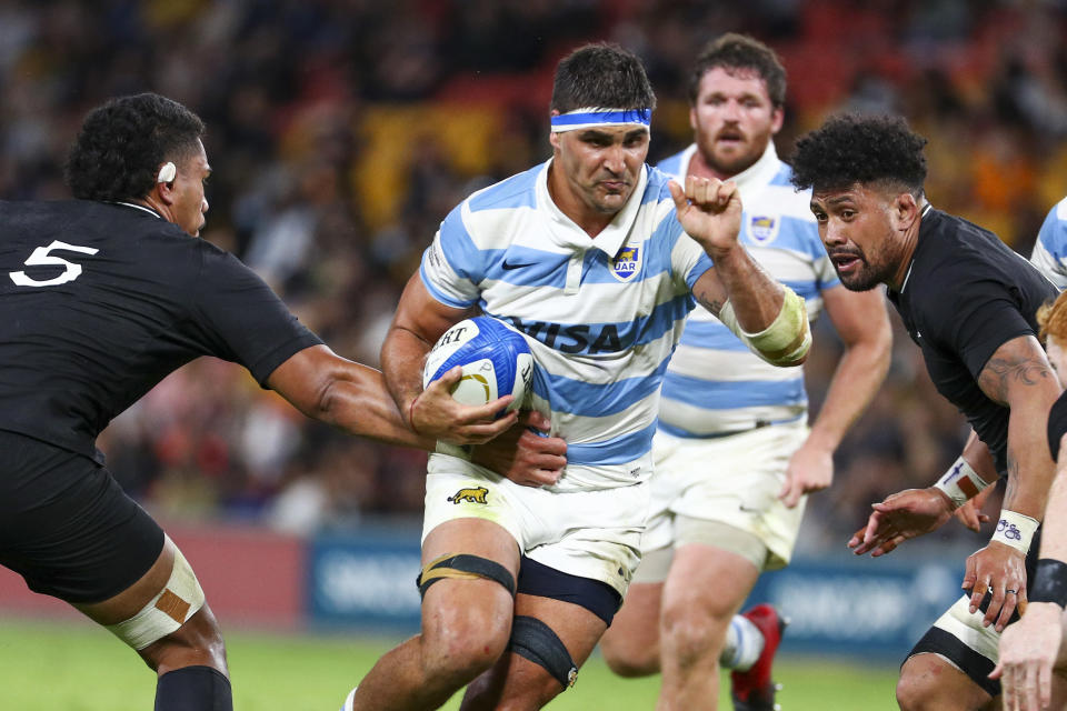 Argentina's Pablo Matera, centre, runs at New Zealand's Tupou Vaa'i, left, and Ardie Savea during the Rugby Championship test match between the All Blacks and the Pumas in Brisbane, Australia, Saturday, Sept. 18, 2021. (AP Photo/Tertius Pickard)