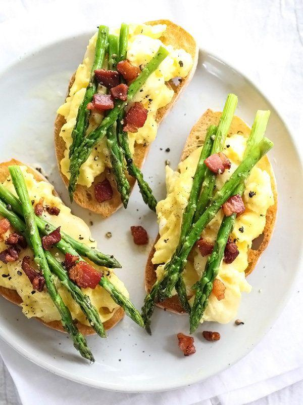 """<strong>Get the <a href=""""http://www.foodiecrush.com/scrambled-egg-and-roasted-asparagus-toasts/"""" rel=""""nofollow noopener"""" target=""""_blank"""" data-ylk=""""slk:Scrambled Egg And Roasted Asparagus Toast recipe"""" class=""""link rapid-noclick-resp"""">Scrambled Egg And Roasted Asparagus Toast recipe</a>&nbsp;from Foodie Crush</strong>"""
