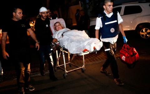 One man was killed and two women were injured in a rocket strike on Ashkelon - Credit: GIL COHEN-MAGEN/AFP/Getty Images