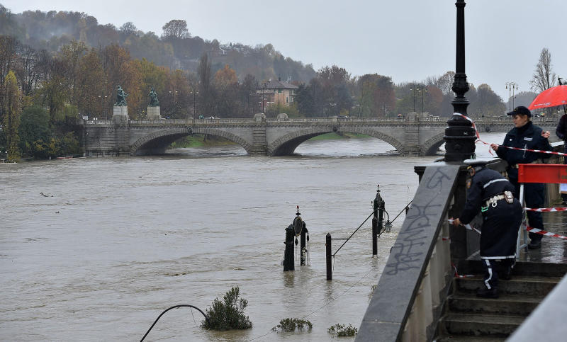 Police seal off a stairway leading to the river banks as the water levels of the river Po rise, in the Murazzi area of Turin