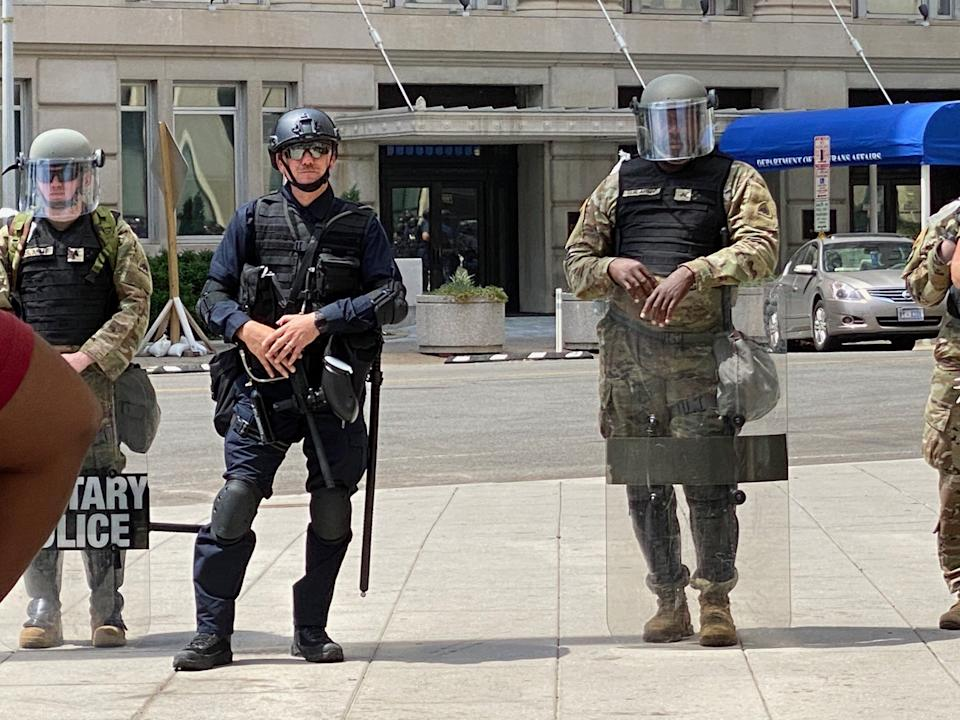 A member of federal law enforcement stands among members of the National Guard on Wednesday. Without nametags or ID on uniforms, especially for officers in riot gear, it could be difficult to identify a particular officer in a misconduct complaint. (Photo: Ryan J. Reilly/HuffPost)