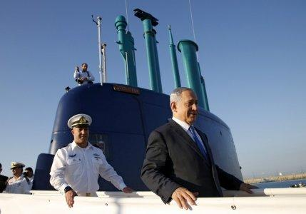 FILE PHOTO: Israeli Prime Minister Benjamin Netanyahu stands ona a navy submarine after it arrived in Haifa port, Israel January 12, 2016. REUTERS/Baz Ratner/File Photo
