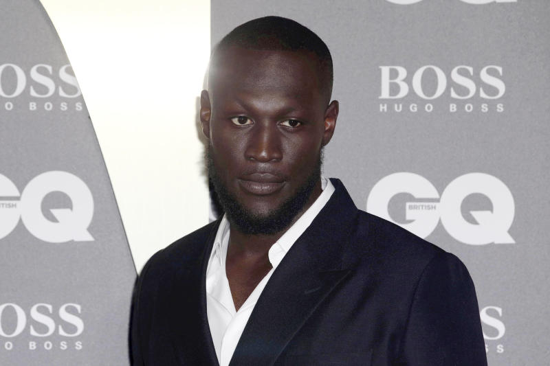 Musician Stormzy poses for photographers on arrival at the GQ Men of the year Awards in central London on Tuesday, Sept. 3, 2019. (Photo by Grant Pollard/Invision/AP)