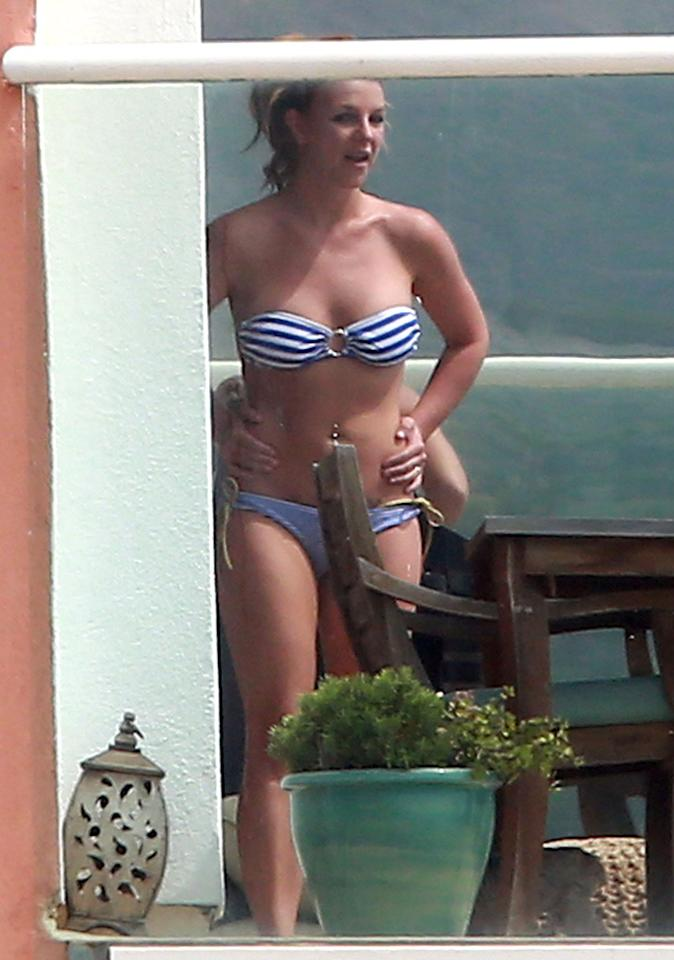 51048616 Singer Britney Spears enjoying some cigarettes and sun while showing off her bikini body at a friends house in Malibu, California on March 25, 2013. FameFlynet, Inc - Beverly Hills, CA, USA -  1 (818) 307-4813