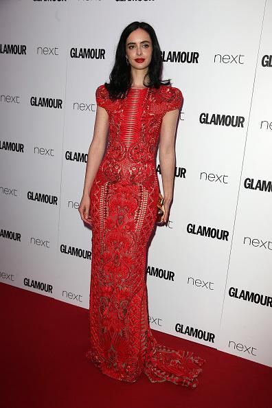 <p>Krysten turned a lot of heads in this racy red number. <i>[Photo: Fred Duval/FilmMagic]</i></p>