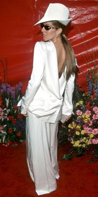 "Photo by: Peter Jordan/PA/ABACA<br />Celine Dion, 1999-<br />Singer Celine Dion tried out a twist on menswearâ€""a 180-degree twist, that is. She showed her major flair for the dramatic in a backwards tuxedo from Christian Dior."