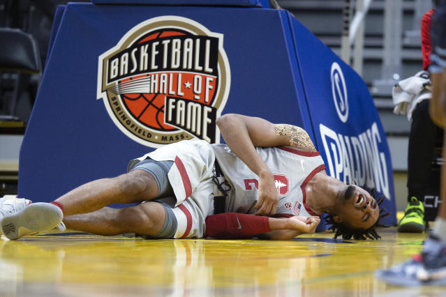 Stanford guard Bryce Wills (2) grimaces in pain after falling hard to the court during the first half of an NCAA college basketball game against San Diego on Saturday, Dec. 21, 2019, in San Francisco. (AP Photo/D. Ross Cameron)
