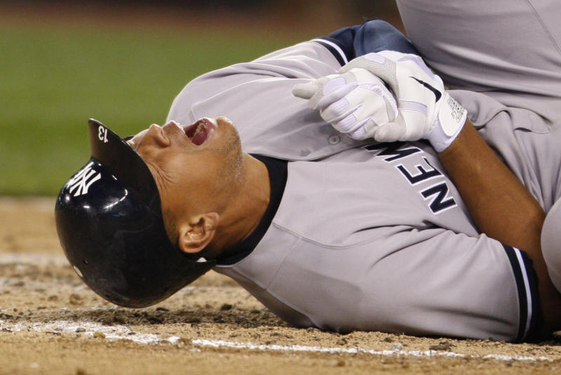 New York Yankees' Alex Rodriguez rolls on the ground after being hit by a pitch in the eighth inning of a baseball game against the Seattle Mariners, Tuesday, July 24, 2012, in Seattle. Even as Rodriguez writhed on the ground in pain, he didn't believe his left hand was fractured.  Turns out A-Rod was wrong, and now the Yankees will be without another of their star players. (AP Photo/Kevin P. Casey)