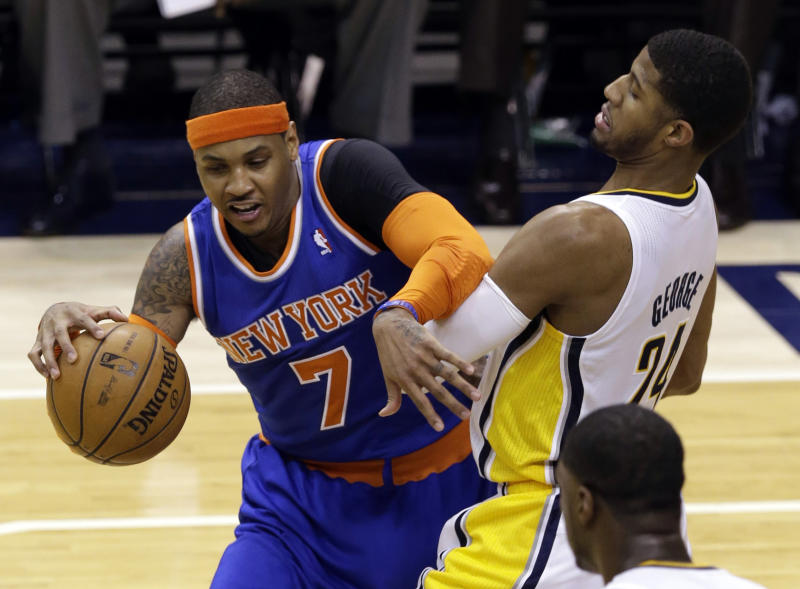 Indiana Pacers forward Paul George, right, gets tangled up with New York Knicks forward Carmelo Anthony during the first half of Game 3 of the Eastern Conference semifinal NBA basketball playoff series in Indianapolis, Saturday, May 11, 2013.  (AP Photo/Michael Conroy)