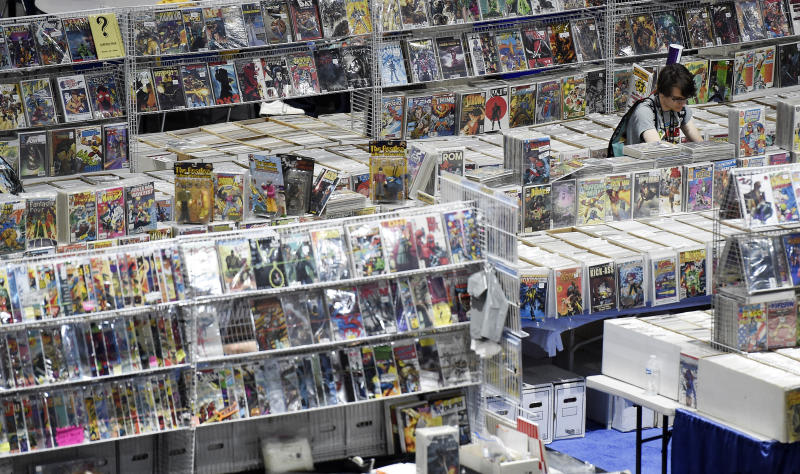 A lone Comic-Con attendee searches through stacks of comic books on the convention floor during Preview Night at the 2019 Comic-Con International: San Diego, Wednesday, July 17, 2019, in San Diego, Calif. (Photo by Chris Pizzello/Invision/AP)