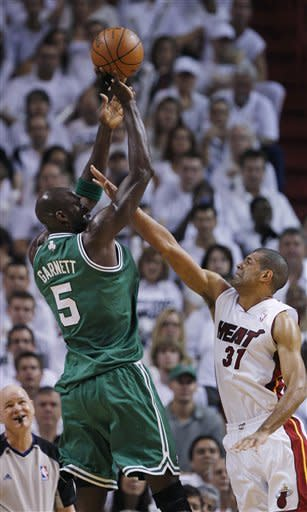 Boston Celtics' Kevin Garnett (5) releases a shot as Miami Heat's Shane Battier (31) defends during the first half of Game 7 of the NBA basketball playoffs Eastern Conference finals, Saturday, June 9, 2012, in Miami. (AP Photo/Lynne Sladky)