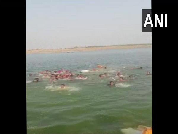 Boat carrying over 40 people to a temple capsized in Chambal river in Rajasthan's Kota on Wednesday. Photo/ANI