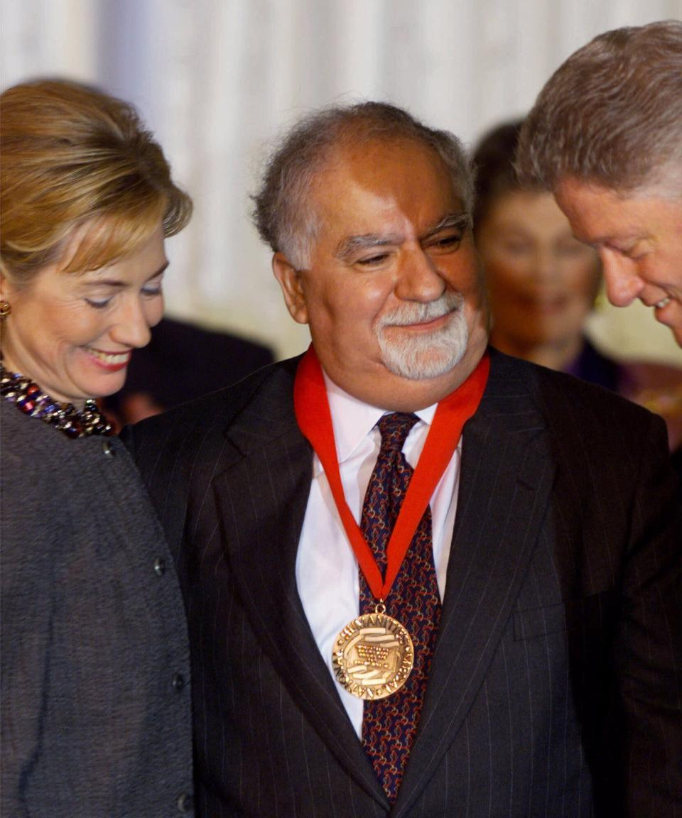 FILE - In this Nov. 5, 1998, file photo, President and Mrs. Clinton flank Vartan Gregorian, an educator, administrator and philanthropist from New York, after presenting him with a 1998 National Humanities Medal during a ceremony at the White House in Washington. Gregorian, the noted scholar and philanthropic leader who has led the Carnegie Corporation of New York since 1997, died Thursday, April 15, 2021, after being hospitalized for stomach pain. He was 87. (AP Photo/Doug Mills, File)