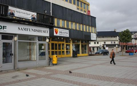"""Help Frode home!"" reads a sign hanging next to the Kirkenes library - Credit: Alec Luhn/For The Telegraph"