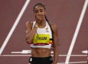 Nafissatou Thiam, of Belgium reacts after winning the gold medal in the heptathlon at the 2020 Summer Olympics, Thursday, Aug. 5, 2021, in Tokyo, Japan. (AP Photo/Charlie Riedel)