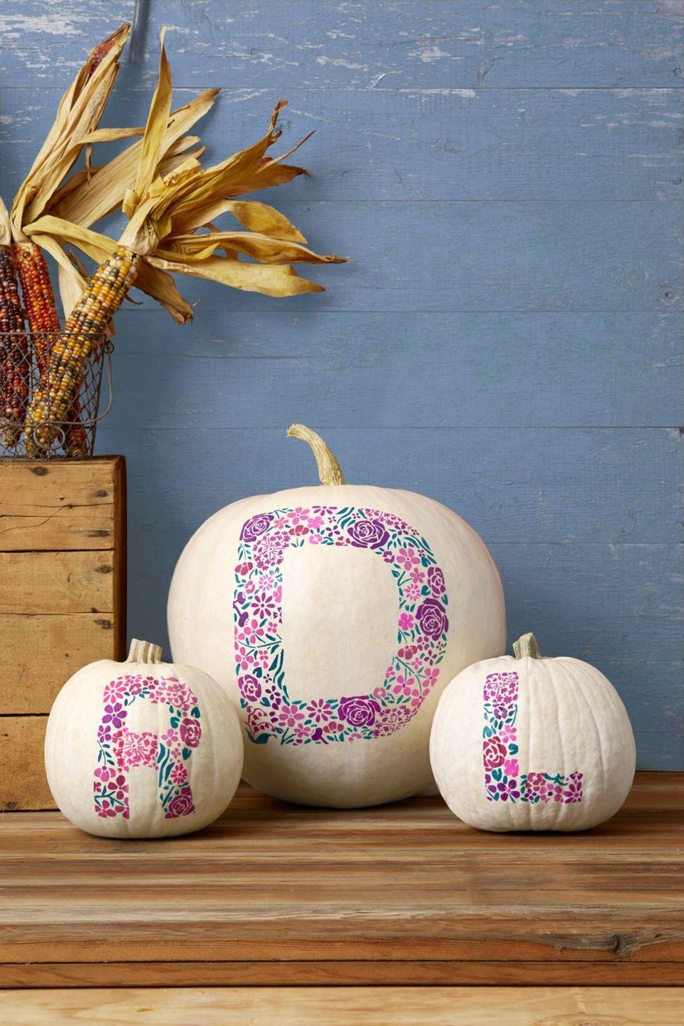 """<p>Have your pumpkin be a reflection of your personal style by painting it with a fun floral monogram. </p><p><strong><em>Get the tutorial at <a href=""""https://www.thepioneerwoman.com/holidays-celebrations/g32223401/pumpkin-decorating-ideas/"""" rel=""""nofollow noopener"""" target=""""_blank"""" data-ylk=""""slk:The Pioneer Woman"""" class=""""link rapid-noclick-resp"""">The Pioneer Woman</a>. </em></strong> </p>"""